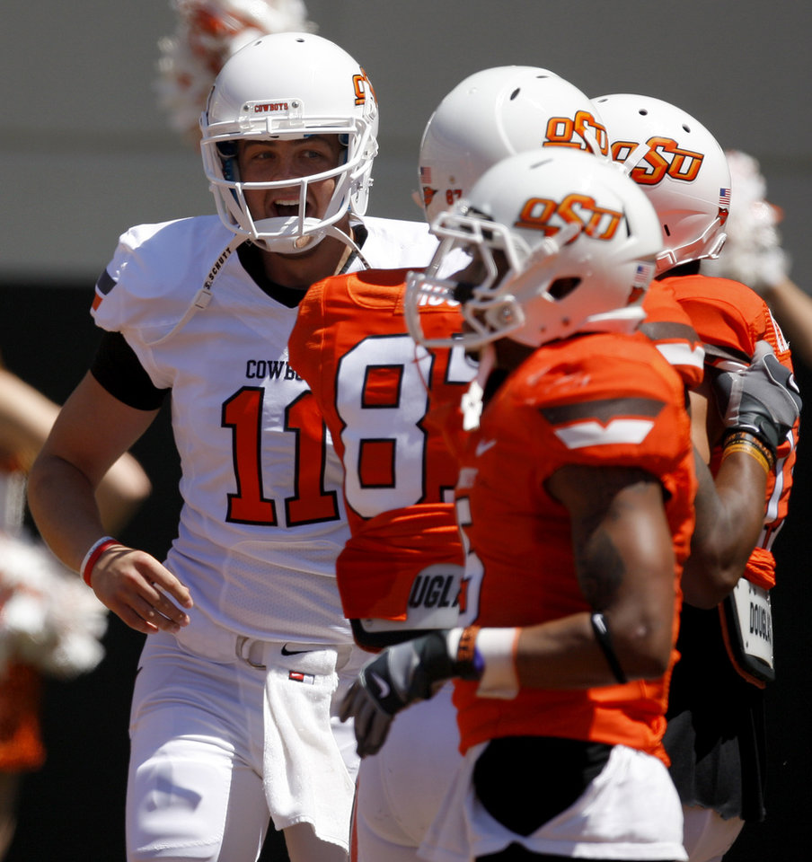 Photo - OSU's Wes Lunt celebrates after a touchdown pass during Oklahoma State's spring football game at Boone Pickens Stadium in Stillwater, Okla., Saturday, April 21, 2012. Photo by Bryan Terry, The Oklahoman