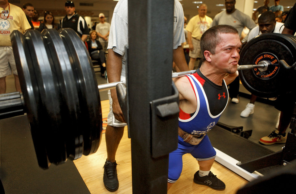 Dustin Cichon lifts 315 pounds on his squat during the powerlifting competition for the Special Olympics at Oklahoma State University (OSU) on Wednesday, May 13, 2009, in Stillwater, Okla.   Photo by Chris Landsberger, The Oklahoman