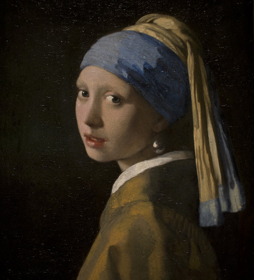 Photo - This reproduction shows a part of Johannes Vermeer's Girl with a Pearl Earring (painted approximatetely 1665) at the renovated Mauritshuis museum during a preview for the press in The Hague, Netherlands, Friday, June 20, 2014. The Mauritshuis reopens after a two-year renovation that allowed its masterpieces, including Vermeer's The Girl with the Pearl Earring to be seen by record-setting crowds abroad. The public will have access for free from 8 pm till midnight on Friday June 27th after the official ceremonial opening and from June 28 onwards the museum will revert to regular opening hours. (AP Photo/Peter Dejong)