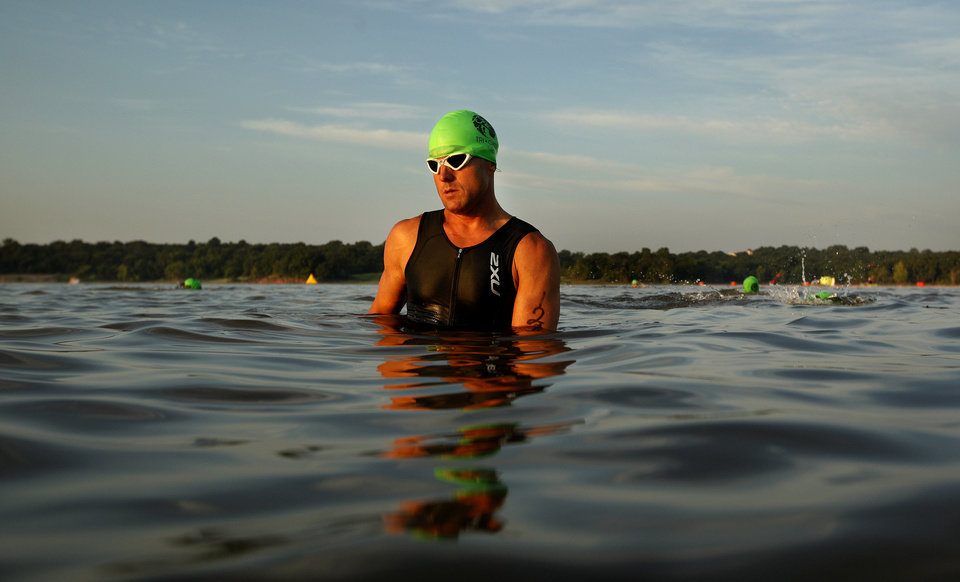 Rian Smoak  of Edmond. Okla., waits to start during the Arcadia Lake Triathlon and Aquabike in at Edmond Park in Arcadia Lake, Sunday, Aug 11, 2013. The race was 500 yd swim, 12.4 Mile/20k bike and a 3.1 mile/5k run. Photo by Sarah Phipps, The Oklahoman