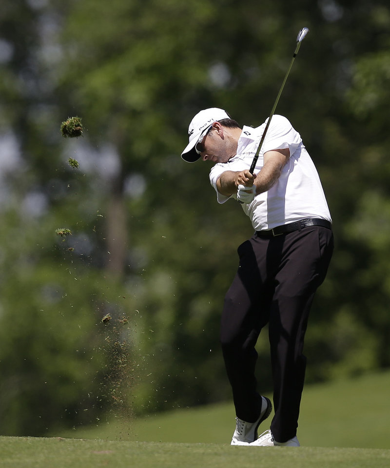 Photo - Ben Curtis hits from the ninth fairway during the second round of the Memorial golf tournament Friday, May 30, 2014, in Dublin, Ohio. (AP Photo/Darron Cummings)