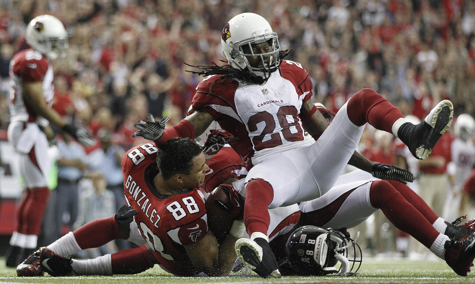 Atlanta Falcons tight end Tony Gonzalez (88) looks to an official after making a catch as Arizona Cardinals cornerback Greg Toler (28) looks on during the second half of an NFL football game Sunday, Nov. 18, 2012, in Atlanta. The Falcons won 23-19. (AP Photo/David Goldman)