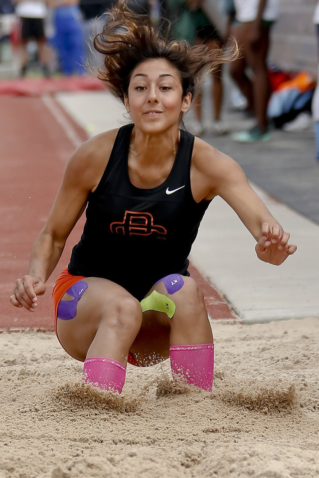 Photo - Putnam City's Schuyler Wood competes in the Class 6A girls long jump during the Class 6A and 5A state championship track meet at Yukon High School on Saturday, May 17, 2014 in Yukon, Okla.   Photo by Chris Landsberger, The Oklahoman