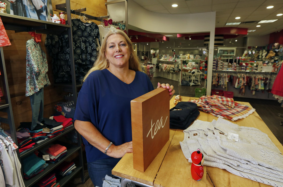 Photo -  Kelly Smith, owner of Keedo Kids Clothing, is one of the many merchants in the Shoppes at Northpark that are part of the new NOMA district on N May.  [Photo by Paul Hellstern, The Oklahoman]