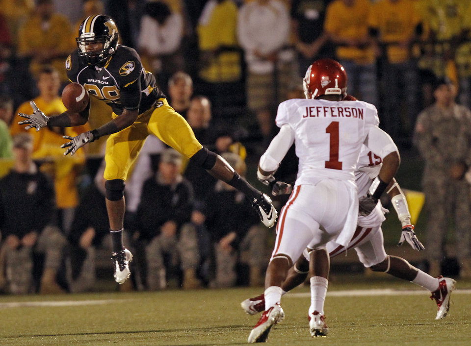 Photo - Missouri's Jerrell Jackson (29) makes a catch for a touchdown in front of Oklahoma's Tony Jefferson (1) during the second half of the college football game between the University of Oklahoma Sooners (OU) and the University of Missouri Tigers (MU) on Saturday, Oct. 23, 2010, in Columbia, Mo. Oklahoma lost the game 36-27. Photo by Chris Landsberger, The Oklahoman
