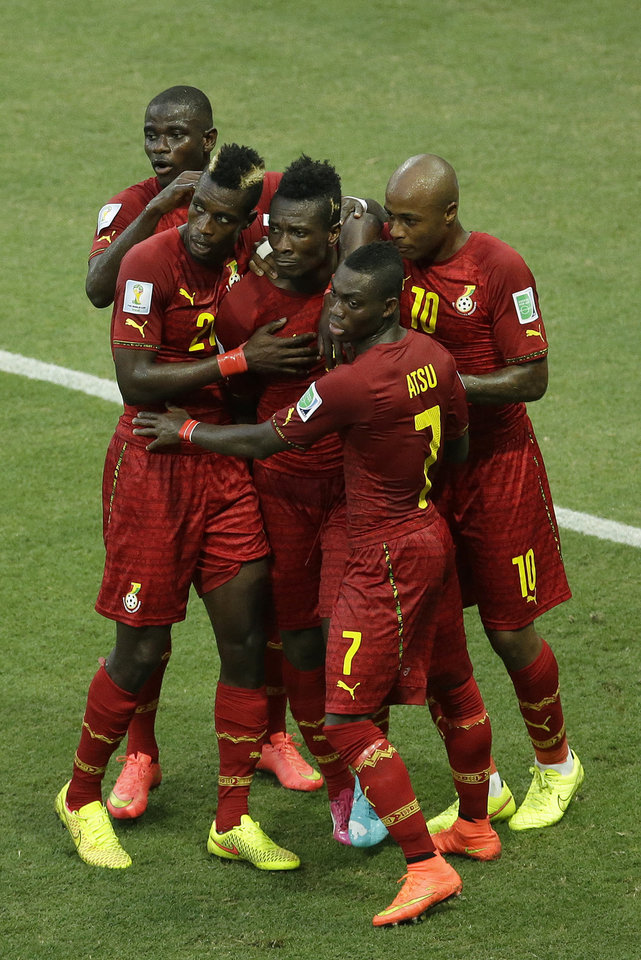 Photo - Ghana's Asamoah Gyan, center, celebrates with teammates after scoring his side's second goal during the group G World Cup soccer match between Germany and Ghana at the Arena Castelao in Fortaleza, Brazil, Saturday, June 21, 2014. (AP Photo/Themba Hadebe)