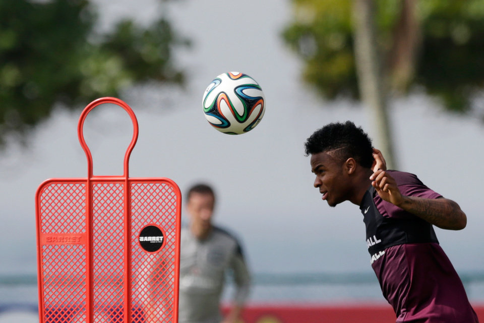 Photo - England national soccer team player Raheem Sterling heads a ball during a squad training session for the 2014 soccer World Cup at the Urca military base in Rio de Janeiro, Brazil, Wednesday, June 11, 2014.  The England soccer team are staying in Rio de Janeiro as their base city for the 2014 soccer World Cup.  (AP Photo/Matt Dunham)
