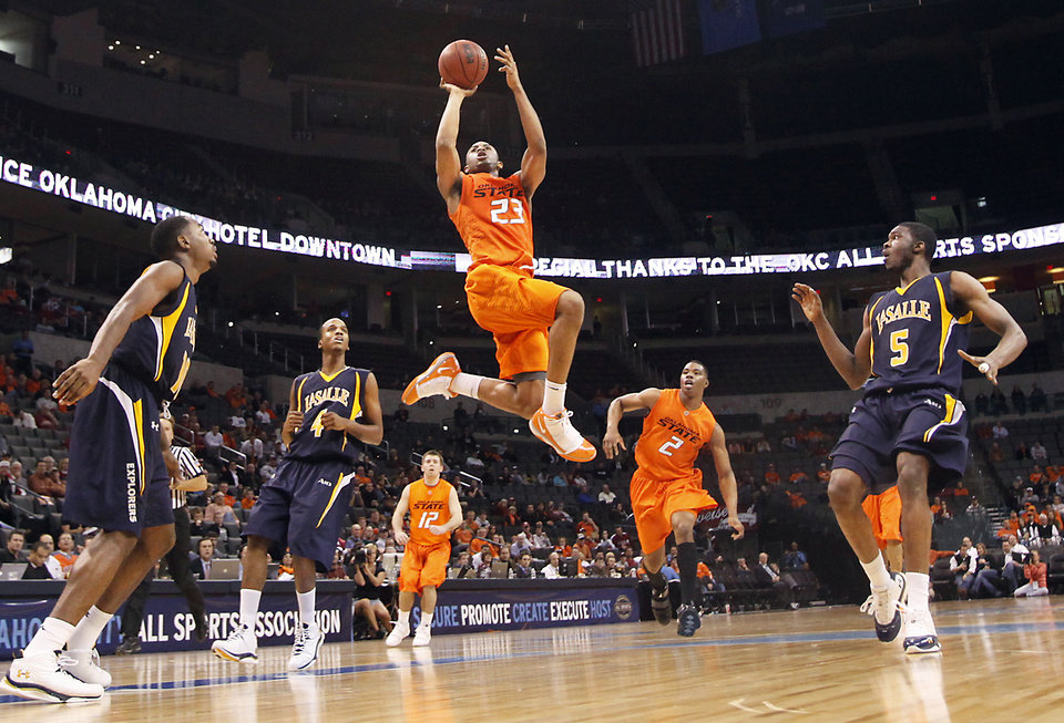 OSU's James Anderson drives to the basket during the Cowboys' 77-62 win over La Salle on Monday in the All-College Classic at the Ford Center.  PHOTO BY CHRIS LANDSBERGER, THE OKLAHOMAN