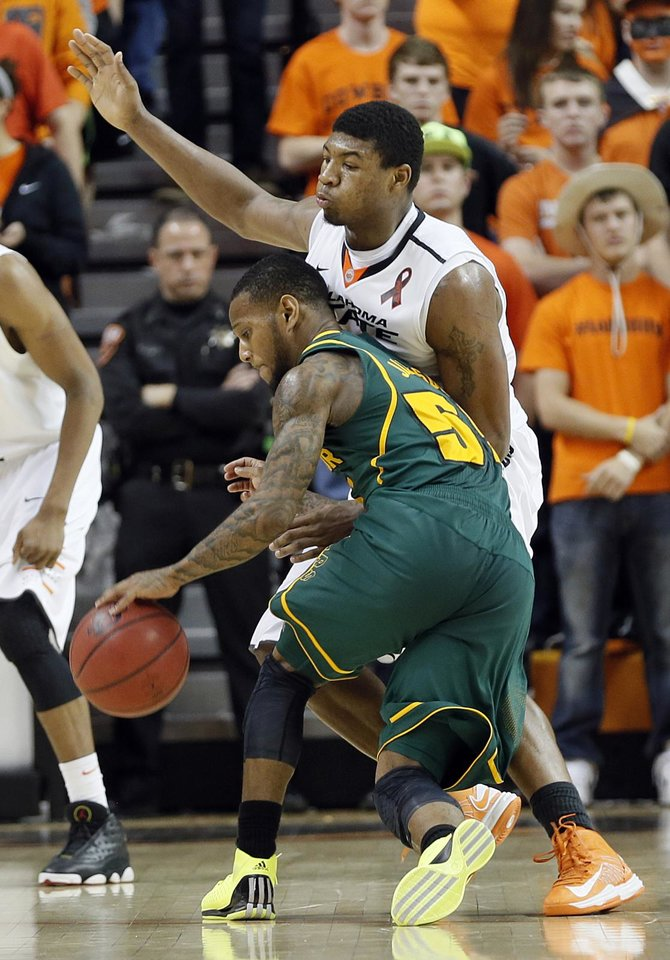 Baylor's Pierre Jackson (55) collides with Oklahoma State 's Marcus Smart (33) during the college basketball game between the Oklahoma State University Cowboys (OSU) and the Baylor University Bears (BU) at Gallagher-Iba Arena on Wednesday, Feb. 5, 2013, in Stillwater, Okla. Photo by Chris Landsberger, The Oklahoman