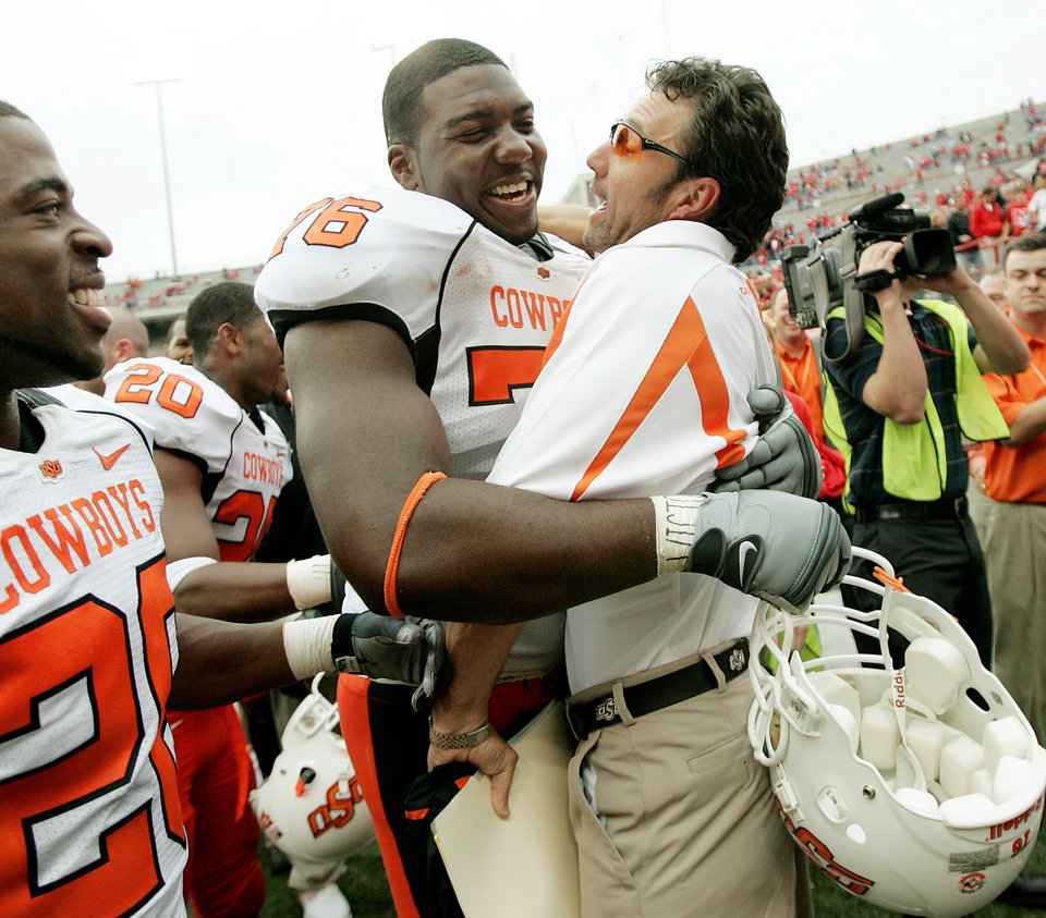 Photo - CELEBRATE, CELEBRATION: Russell Okung of OSU celebrates with Larry Fedora after their win in the college football game between Oklahoma State University (OSU) and the University of Nebraska at Memorial Stadium in Lincoln, Neb., on Saturday, Oct. 13, 2007. By Bryan Terry, The Oklahoman    ORG XMIT: KOD