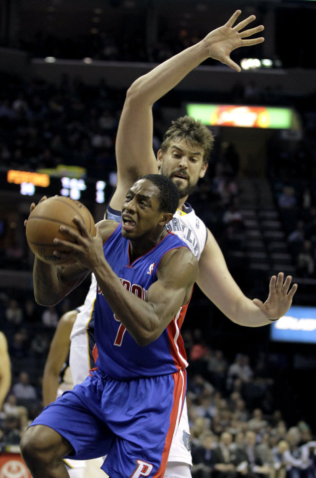 Photo - Detroit Pistons' Brandon Knight (7) goes to the basket under Memphis Grizzlies' Marc Gasol (33), of Spain, during the first half of an NBA basketball game in Memphis, Tenn., Friday, Nov. 30, 2012. (AP Photo/Danny Johnston)