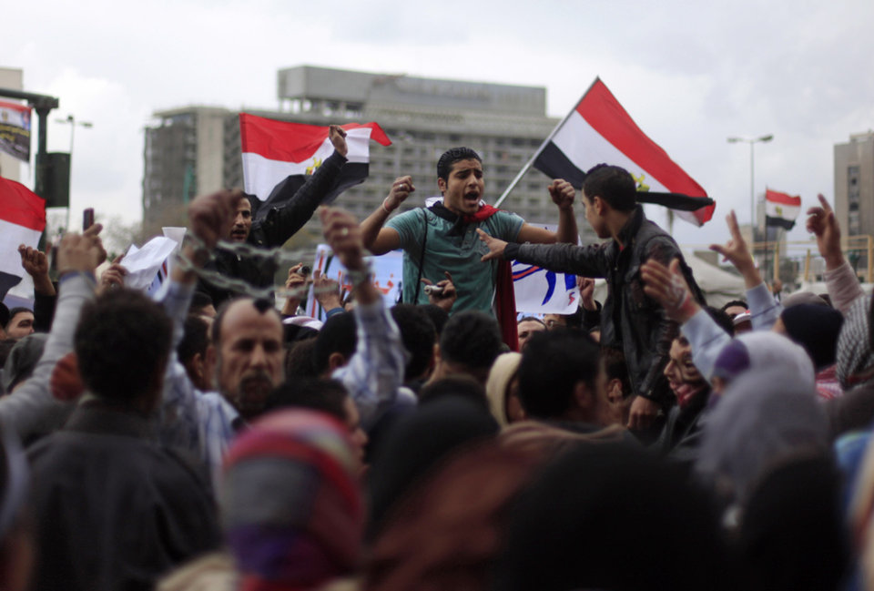 Photo - Egyptian protesters chant anti-government slogans during a rally in Tahrir Square, Cairo, Egypt, Friday, Feb. 1, 2013. Thousands of Egyptians marched across the country, chanting against the rule of the Islamist President Mohammed Morsi, in a fresh wave of protests Friday, even as cracks appeared in the ranks of the opposition after its political leaders met for the first time with the rival Muslim Brotherhood. (AP Photo/Khalil Hamra)