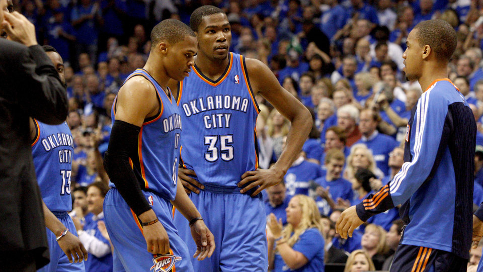 Photo - Oklahoma City's Kevin Durant (35) and Russell Westbrook (0) react during game 5 of the Western Conference Finals in the NBA basketball playoffs between the Dallas Mavericks and the Oklahoma City Thunder at American Airlines Center in Dallas, Wednesday, May 25, 2011. Photo by Bryan Terry, The Oklahoman