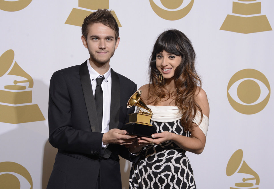 """Photo - Zedd, left, and Foxes pose in the press room with the award for best dance recording for """"Clarity"""" at the 56th annual Grammy Awards at Staples Center on Sunday, Jan. 26, 2014, in Los Angeles. (Photo by Dan Steinberg/Invision/AP)"""
