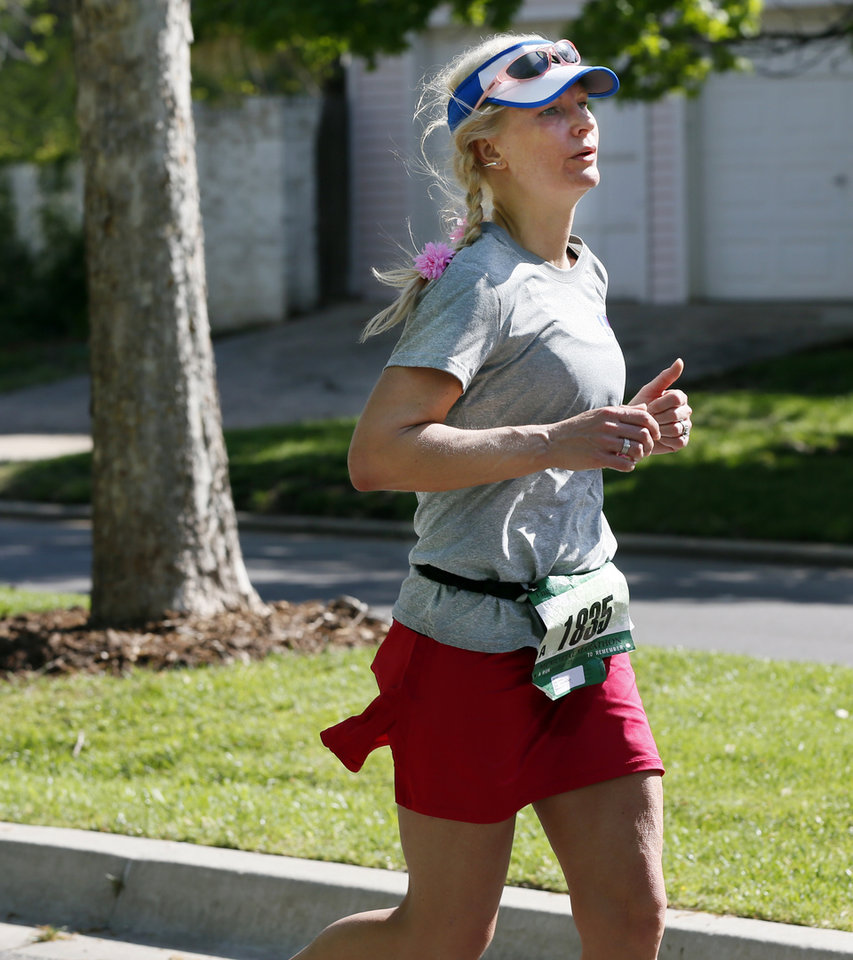 Cari Yerkes runs in Heritage Hills during the Oklahoma City Memorial Marathon in Oklahoma City, Sunday, April 28, 2013. Photo by Nate Billings, The Oklahoman