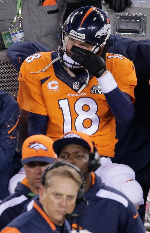 Photo - Denver Broncos' Peyton Manning watches play against the Seattle Seahawks during the second half of the NFL Super Bowl XLVIII football game Sunday, Feb. 2, 2014, in East Rutherford, N.J. (AP Photo/Charlie Riedel)