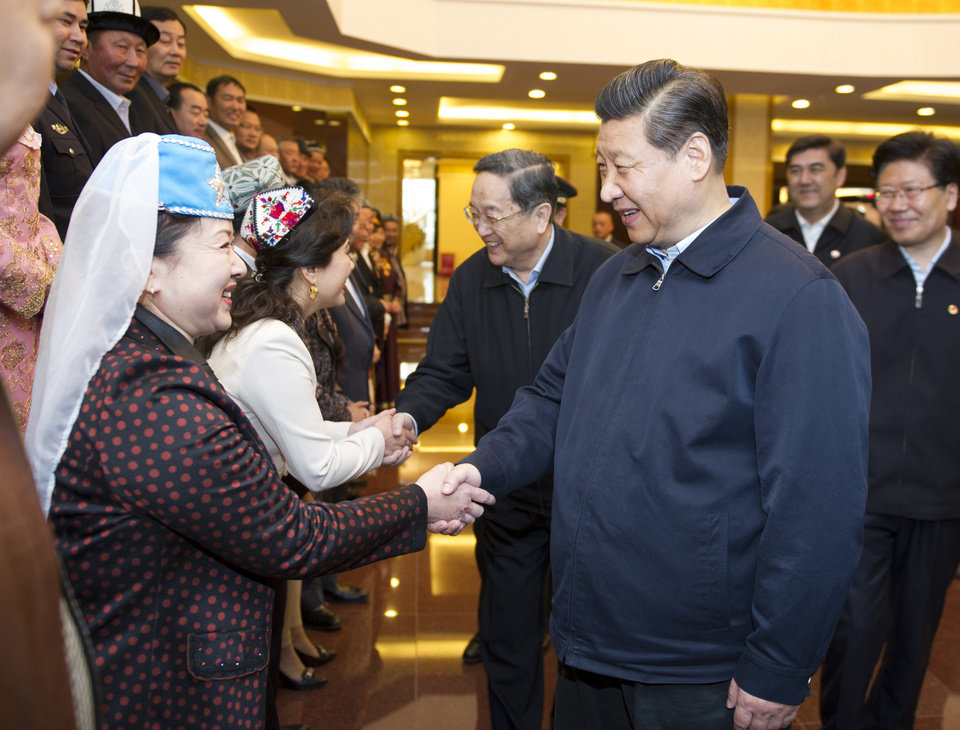 Photo - In this Wednesday, April 30, 2014 photo released by China's Xinhua News Agency, Chinese President Xi Jinping, front right,shakes hands with model workers and outstanding figures in Urumqi, capital of northwest China's Xinjiang Uygur Autonomous Region. Xi had an inspection tour in Xinjiang from April 27 to April 30. (AP Photo/Xinhua, Xie Huanchi) NO SALES