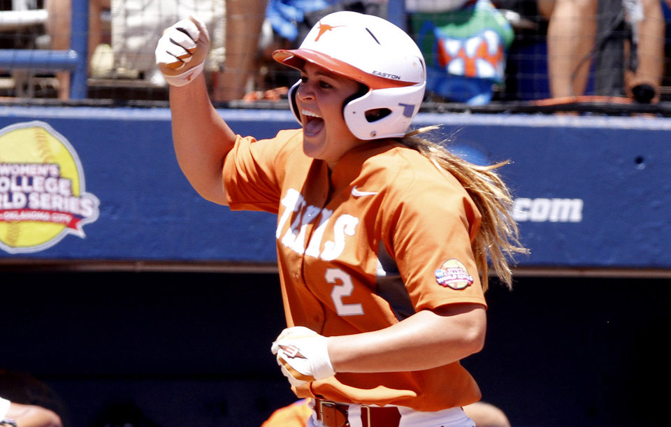 Texas designated player Kim Bruins celebrates while running to home plate after hitting the game winning three-run home run in the Women\'s College World Series elimination game versus Florida. The Longhorns would go on to win 3-0. Photo by KT KING, The Oklahoman