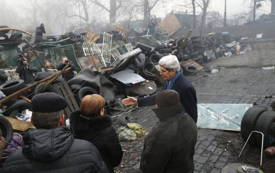 Photo - Secretary of State John Kerry stands beside a barricade at the Shrine of the Fallen in Kiev,Ukraine, Tuesday, March 4, 2014. The Shrine of the Fallen, located on Institutska Street, honors the fallen Heroes of the
