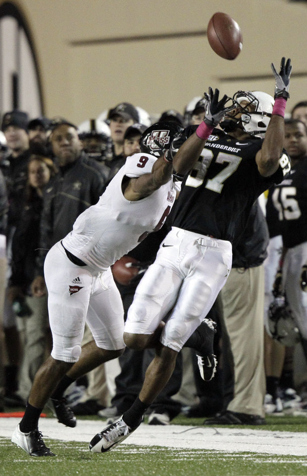 Photo -   Vanderbilt wide receiver Jordan Matthews (87) catches a pass for a first down next to Massachusetts defensive back Christian Birt (9) during the first quarter of an NCAA college football game Saturday, Oct. 27, 2012, in Nashville, Tenn. (AP Photo/Wade Payne)