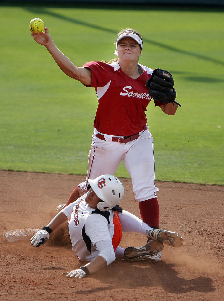 Photo - Oklahoma's Georgia Casey tries to turn a double as Oregon State's Dani Gilmore slides into second an NCAA softball regional between the University of Oklahoma and  Oregon State in Norman, Okla., Sunday, May 20, 2012. Photo by Sarah Phipps, The Oklahoman