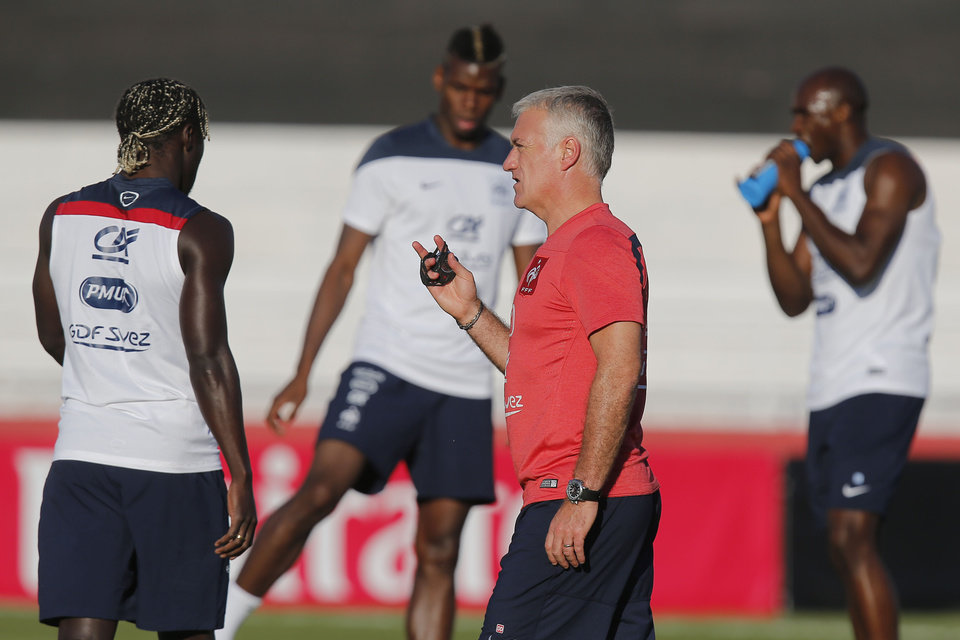 Photo - France's head coach Didier Deschamps talks to his layers during a during a training session at the Santa Cruz stadium, in Ribeirao Preto, Brazil, Saturday, June 21, 2014. France faces Ecuador, Switzerland and Honduras in group E of the World Cup. Having captured people's attention at the soccer World Cup with some scintillating attacking football, France's players are now in unknown territory after raising expectations back home, having routed Switzerland and Honduras. (AP Photo/David Vincent)