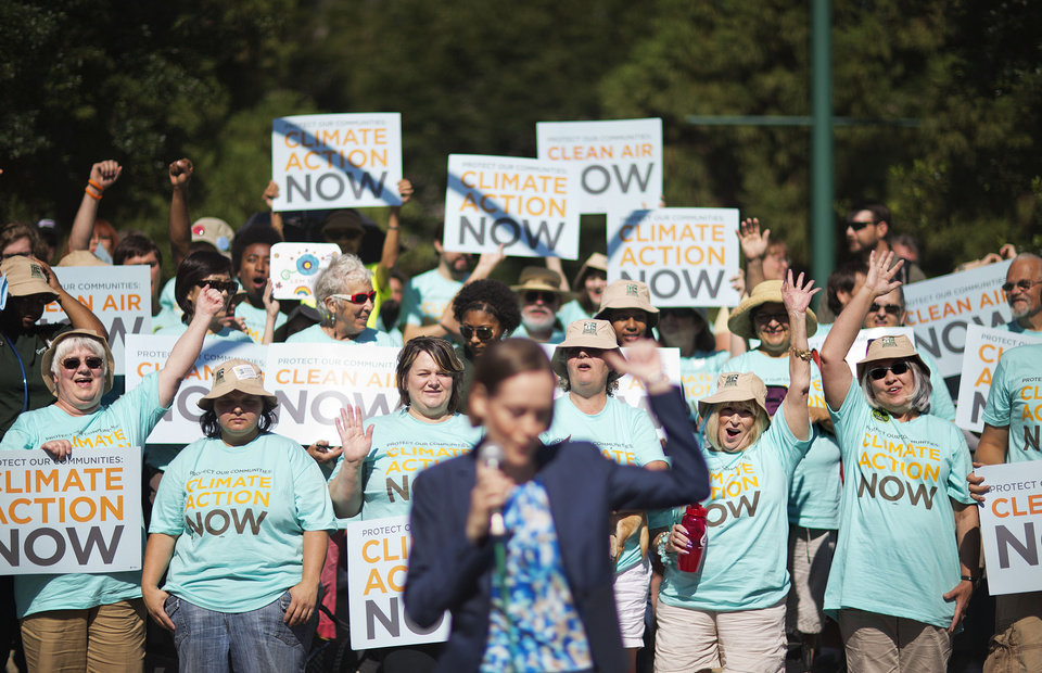 Photo - Clean air advocates cheer as Mary Anne Hitt, director of the Sierra Club's Beyond Coal Campaign, speaks at a rally outside an Environmental Protection Agency hearing, Tuesday, July 29, 2014, in Atlanta. Utility and coal companies are expected to argue Tuesday against proposals from the Obama administration that would force a 30 percent cut in carbon dioxide emissions by the year 2030 from 2005 levels. The EPA is holding three public hearings on the proposal in Atlanta, Denver and Washington. (AP Photo/David Goldman)