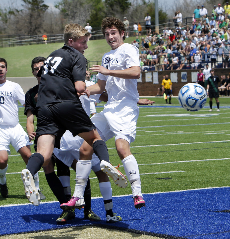 Norman North's Carson Cacciatori, 17, scores with a header in the Class 6A boys state soccer championship game between Edmond North and Norman North on Saturday, May 11, 2013 in Noble, Okla.  Photo by Steve Sisney, The Oklahoman