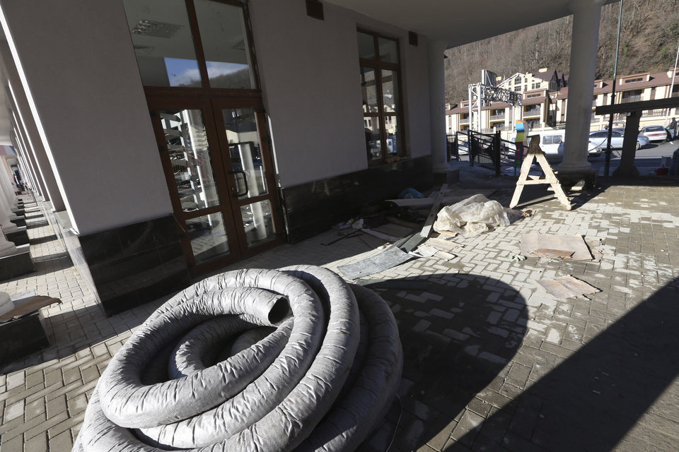 Photo - Building debris is left outside the Gorki Plaza East hotel in Krasnaya Polyana, Russia Sunday, Feb. 2, 2014. The IOC is urging Russian Olympic organizers to move quickly to resolve the issue of accommodations that are not ready for accredited media personnel in the mountains outside Sochi. According to the 2014 Sochi Winter Olympic organizing committee, only six of the nine media hotels in the mountain area are fully operational. (AP Photo/Luca Bruno)