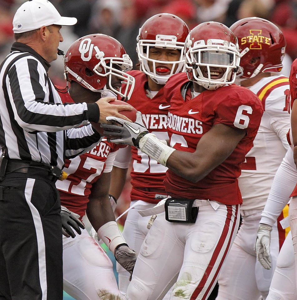 Photo - Oklahoma's Demontre Hurst (6) hands the ball back to an official after a fumble recovery during a college football game between the University of Oklahoma Sooners (OU) and the Iowa State University Cyclones (ISU) at Gaylord Family-Oklahoma Memorial Stadium in Norman, Okla., Saturday, Nov. 26, 2011. Photo by Bryan Terry, The Oklahoman
