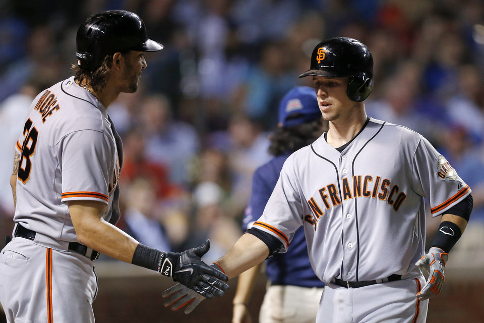 Photo - After hitting a solo home run, San Francisco Giants' Buster Posey, right, celebrates with teammate Michael Morse during the fifth inning of a baseball game against the Chicago Cubs, Thursday, Aug. 21, 2014, in Chicago. (AP Photo/Andrew A. Nelles)