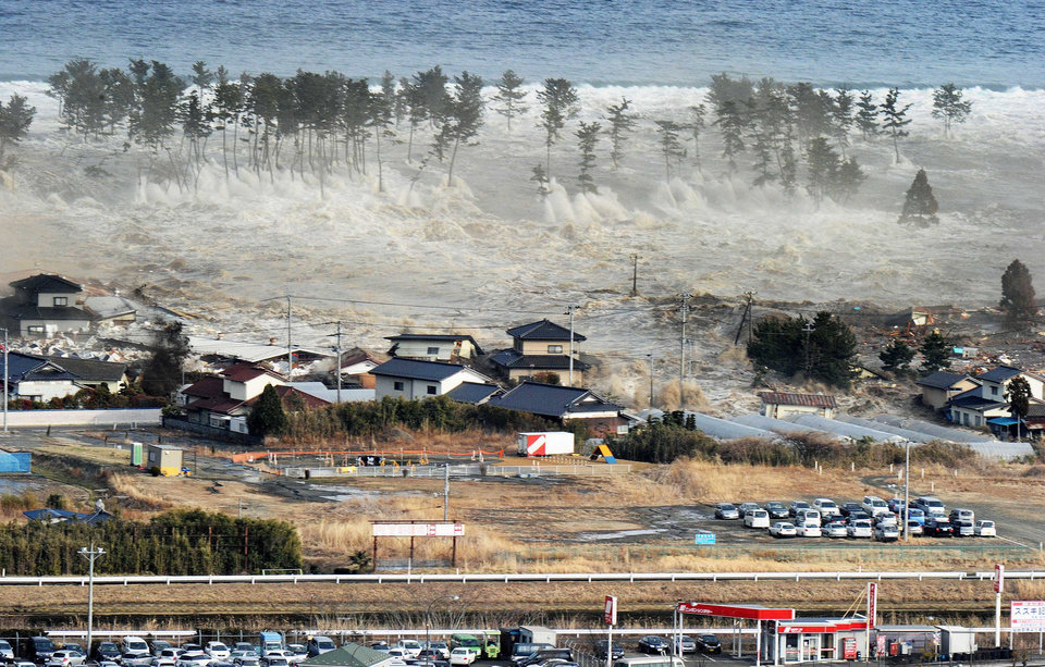 Photo - Waves of tsunami hit residences after a powerful earthquake in Natori, Miyagi prefecture (state), Japan, Friday, March 11, 2011.  The largest earthquake in Japan's recorded history slammed the eastern coast Friday. (AP Photo/Kyodo News) JAPAN OUT, MANDATORY CREDIT, FOR COMMERCIAL USE ONLY IN NORTH AMERICA ORG XMIT: TTX804