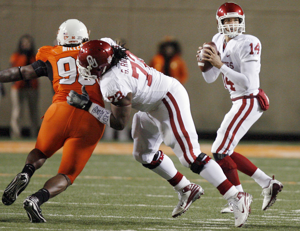 Photo - Oklahoma's Sam Bradford (14) gets protection in the pocket by lineman Duke Robinson (72) during the first half of the college football game between the University of Oklahoma Sooners (OU) and Oklahoma State University Cowboys (OSU) at Boone Pickens Stadium on Saturday, Nov. 29, 2008, in Stillwater, Okla. STAFF PHOTO BY CHRIS LANDSBERGER
