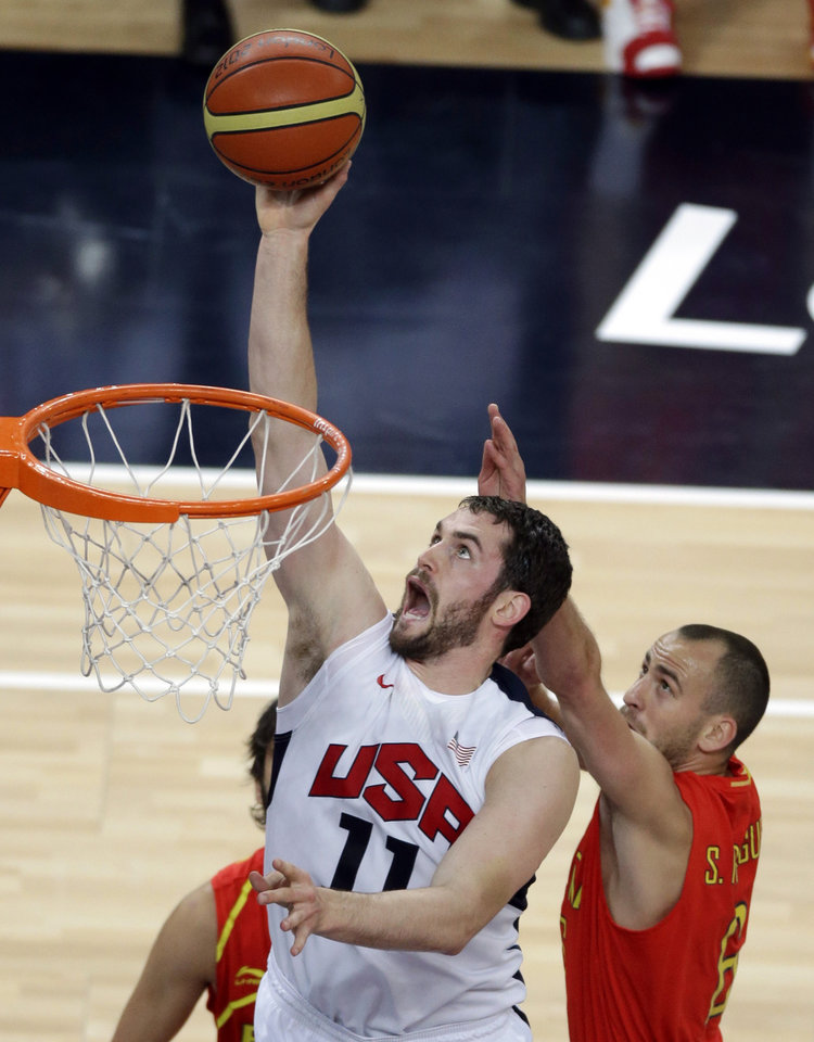 FILE - In this Aug. 12, 2012, file photo, United States' Kevin Love puts up a shot against Spain's Sergio Rodriguez, right, during the men's gold medal basketball game at the 2012 Summer Olympics in London. The London Olympics weren't all fun and games for Love. The Timberwolves star endured pot shots from teammates as the only member of the roster who has not played in the playoffs. Love badly wants that to change. (AP Photo/Victor Caivano, File)