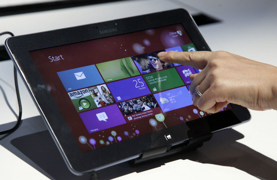 A person tries a Samsung tablet computer running Windows 8 at the launch of Microsoft Windows 8 on Thursday in New York. AP Photo <strong>Richard Drew</strong>