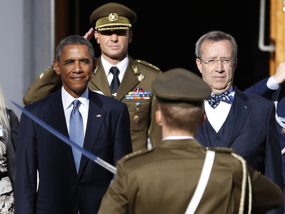 Photo - U.S. President Barack Obama, left, and Estonia's President Toomas Hendrik Ilves, right, attend a welcome ceremony at the Kadriorg Palace in Tallinn, Estonia, Wednesday, Sept. 3, 2014. Spooked by Russia's intervention in Ukraine, Estonia is hoping for a strong signal of support from Obama when he arrives Wednesday in a country that two decades ago had Russian troops on its soil. (AP Photo/Mindaugas Kulbis)