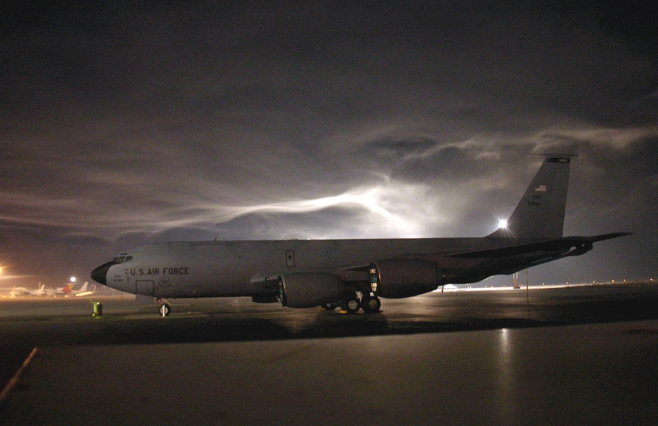 Photo - In this feb. 23, 2006 image provided by the U.S. Air Force, a KC-135 sits on the tarmac at Manas Air Base in Kyrgyzstan. An American KC-135 military refueling plane carrying three crew members crashed Friday, May 3, 2013, in the rugged mountains of Kyrgyzstan, the Central Asian nation where the U.S. operates an air base key to the war in Afghanistan. (AP Photo/U.S. Air Force)