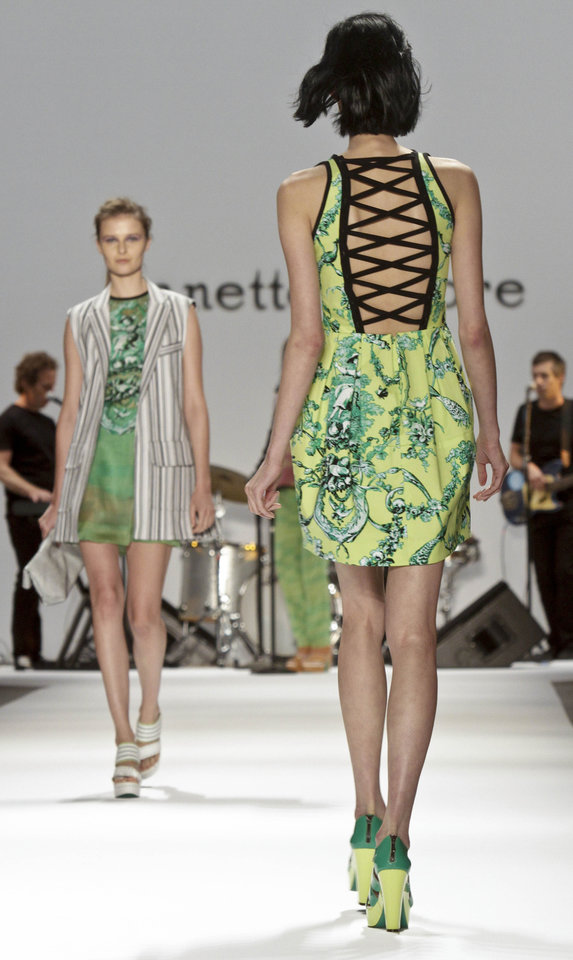 Photo -   Fashion from the Spring 2013 collection of Nanette Lepore is modeled on Wednesday, Sept. 12, 2012 in New York. (AP Photo/Bebeto Matthews)