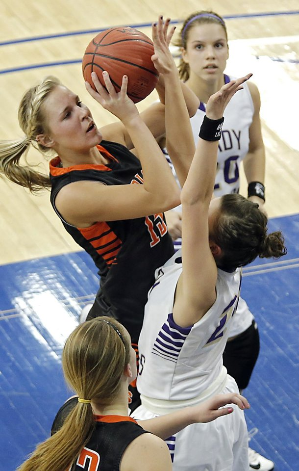 Sterling\'s Madison Bradshaw (15) shoots the ball over Okarche\'s Madison Lee (24) during the Class A girls state quarterfinal game between Okarche and Sterling at Oklahoma City University on Thursday, Feb. 28, 2013, in Oklahoma City, Okla. Photo by Chris Landsberger, The Oklahoman