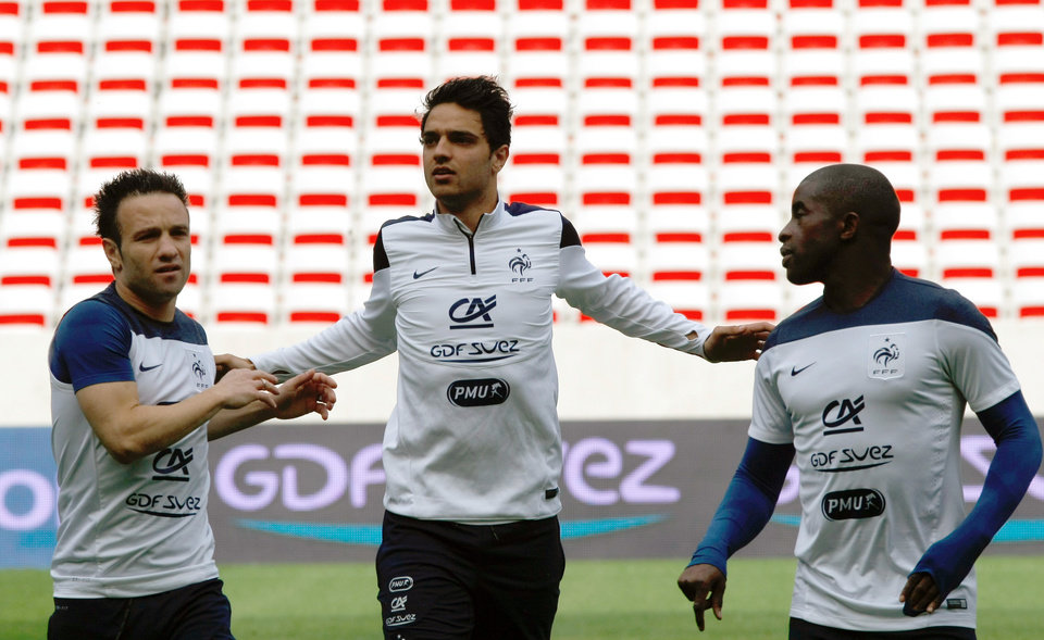 Photo - French soccer team midfielders Mathieu Valbuena, left, Clement Grenier, center, and Rio Mavuba, attends a training session, at the Allianz Riviera Stadium, in Nice, southeastern France, Saturday, May 31, 2014. France, which will face Paraguay on Sunday, is preparing for the upcoming soccer World Cup in Brazil starting on 12 June. (AP Photo/Claude Paris)