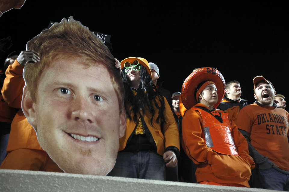 Photo - OSU fans cheer during the Bedlam college football game between the University of Oklahoma Sooners (OU) and the Oklahoma State University Cowboys (OSU) at Boone Pickens Stadium in Stillwater, Okla., Saturday, Nov. 27, 2010. Photo by Sarah Phipps, The Oklahoman