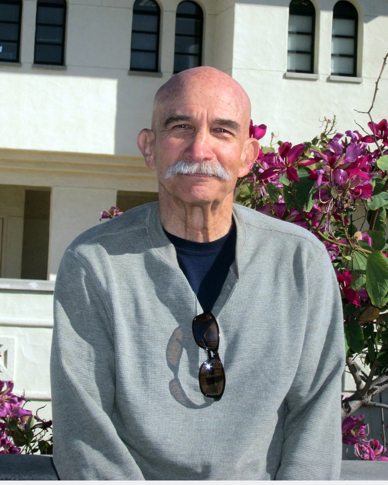 Photo - This undated photo provided by Tony Cherin,, shows Cherin, professor emeritus of finance at San Diego State University, posing for a photo. Cherin supports lifting the minimum wage. (AP Photo/Tony Cherin)