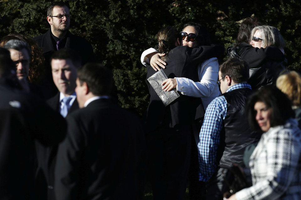 People hug as they wait outside of the First Congregational Church before a memorial service for Lauren Rousseau in Danbury, Conn., Thursday, Dec. 20, 2012.   Rousseau, 30, was killed when Adam Lanza walked into Sandy Hook Elementary School in Newtown, Dec. 14, and opened fire, killing 26 people, including 20 children, before killing himself.  (AP Photo/Seth Wenig)