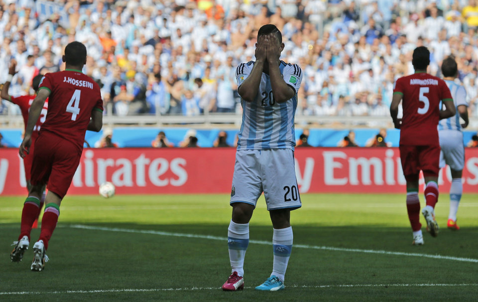 Photo - Argentina's Sergio Aguero reacts after missing a chance during the group F World Cup soccer match between Argentina and Iran at the Mineirao Stadium in Belo Horizonte, Brazil, Saturday, June 21, 2014. (AP Photo/Victor R. Caivano)