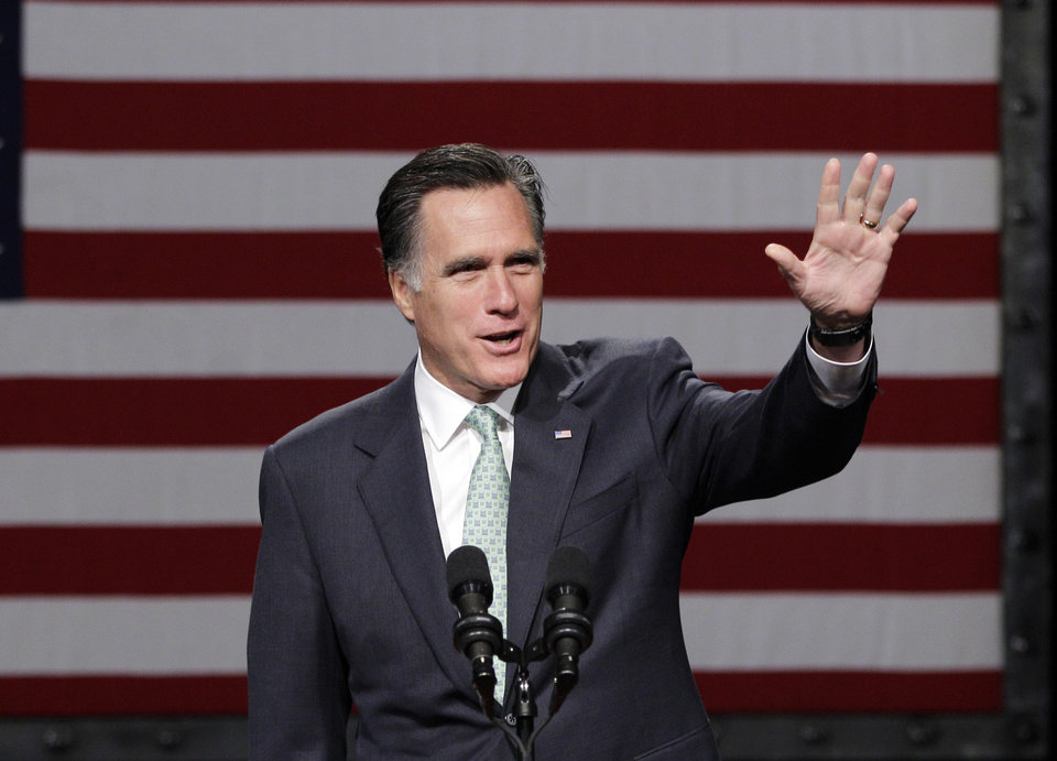Photo -   Republican presidential candidate, former Massachusetts Gov. Mitt Romney speaks at Lansing Community College in Lansing, Mich., Tuesday, May 8, 2012. (AP Photo/Carlos Osorio)
