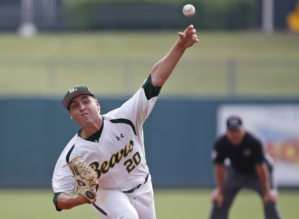 Photo - Baylor's Daniel Castano (20) pitches in the first inning of a game against TCU in the Big 12 conference NCAA college baseball tournament in Oklahoma City, Saturday, May 24, 2014. (AP Photo/Sue Ogrocki)