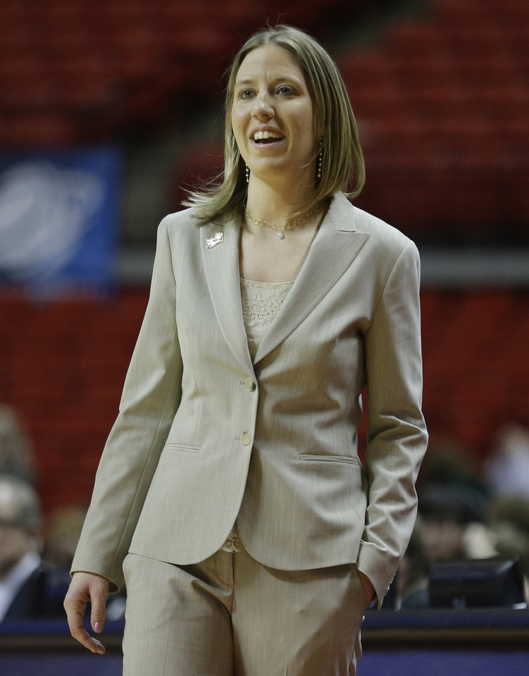 California head coach Lindsay Gottlieb smiles as she watches her team play during the second half of a second-round game against South Florida in the women\'s NCAA college basketball tournament in Lubbock, Texas, Monday, March 25, 2013. California won 82-78 in overtime. (AP Photo/LM Otero)