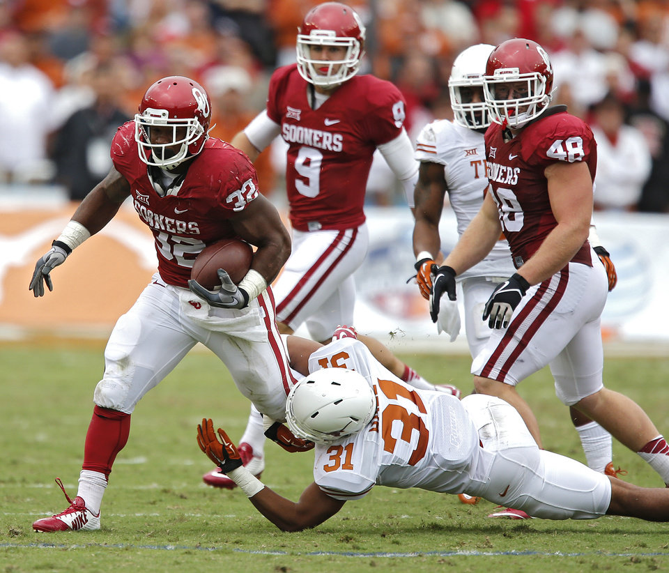 Photo - Oklahoma's Samaje Perine (32) runs past Texas' Jason Hall (31) during the college football game between the University of Oklahoma Sooners (OU) and the University of Texas Longhorns (UT) during the Red River Showdown at the Cotton bowl in Dallas, Texas on Saturday, Oct. 11, 2014. Photo by Chris Landsberger, The Oklahoman