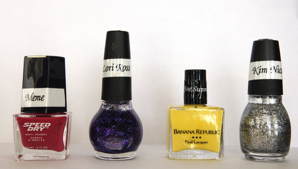Photo - Nail polish given to Lorelei Decker of Oklahoma City comes in various hues.  David McDaniel - The Oklahoman