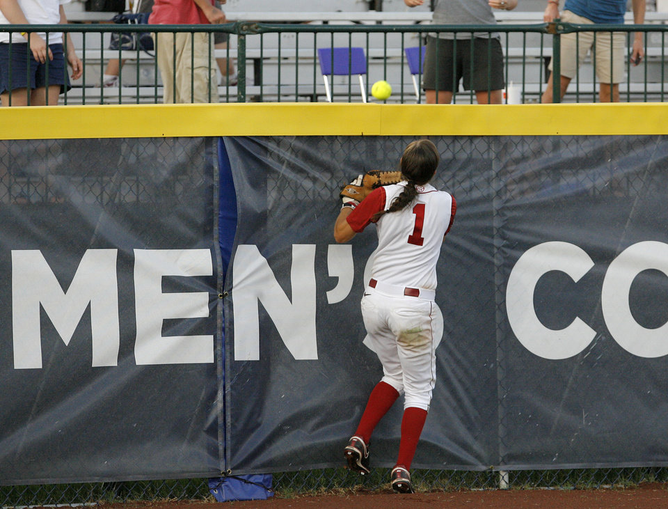 Photo - Alabama's Kayla Braud (1) misses a cate over the center-field wall during the Women's College World Series game between Alabama and Florida at the ASA Hall of Fame Stadium in Oklahoma City, Sunday, June 5, 2011. Photo by Garett Fisbeck, The Oklahoman